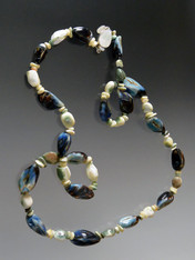 This summery rope features Rare Phillippine Mactan mactan Phillippine Pearl Shells spaced with mother-of pearl
