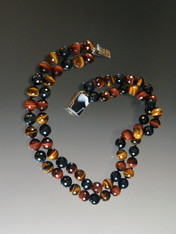 "This exceptional quality tiger eye necklace features rare multi-toned faceted beads with flashes of brown, wine, black and blue.  Totally gorgeous with any outfit.  Choose two strands 20"" or one strand 18"""