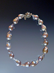 If you're a pearl lover, you'll marvel over this stunning one-of-a-kind baroque pearl necklace.  Luminous gray, silver with undertones of rose, each bead is a sculptural masterpiece.  Hand-knotted  in silk with a rare mabe pearl sterling silver clasp in the same tones.  18""
