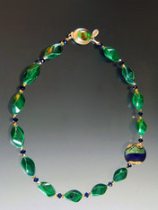 "This necklace has it all -richly patterned malachite swirls, a large 24K green blue and gold Venetian glass disc, and sparkling 24K and indigo blue Swarovski crystals. 20"" ONLY TWO!"
