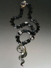 "This spectacular necklace features rare Grade AAA trillion cut Brazilian black tourmaline, black Venetian window beads with sterling silver and a luxurious Venetian glass silver and black flecked serpent pendnt. This is truly ONE OF A KIND because I can never find this quality tourmaline again. Necklace 20""  Serpent 3"" x 2"""