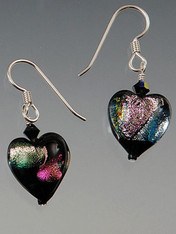 "These ""decadent"" iridescent black/violet shimmering dichroic heart earrings are topped with a Swarovski crystal suspended from sterling earwires.  They're all you need to make a statement 1"""