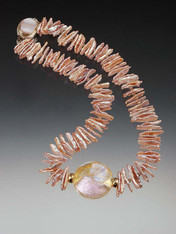 This dramatic glittering necklace makes a statement without your saying a word and is perfect for the new spring summer palette.  It features a limited edition Venetian dichroic disc flashing shades of pink, silver and gold, framed by two large 14K stations, in the center of grade AAA pastel pink biwa pearls with tiny cognac Swarovski crystals.  18""
