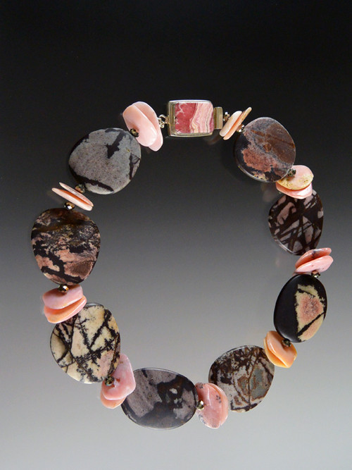 """This dramatic and rare Australian Outback Jasper collar makes a bold statement in the season's """"in"""" colors.  Each This dramatic rare Australian Outback Jasper collar makes a bold """"earthy"""" statement.  Outback Jasper was mined commercially for the first time last year in the midwest region of Western Australia, outside Perth. Each freeform stone features intricate natural patterns in shades of dark brown, gray, black, and dusty pink spaced with freeform large pink opal discs and finished with a vintage sterling rhodochrosite csterling clasp. Clasp will vary. 20""""  ONLY THREE AVAILABLE"""