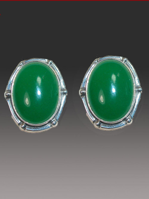 """Green is THE color this season and these striking Amy Kahn Russell earrings will go with everything in your wardrobe. They feature bright green onyx cabochons bezel set in an intricate sterling silver frame. 1"""" x 3/4"""" Clips   Convert to posts for $15."""