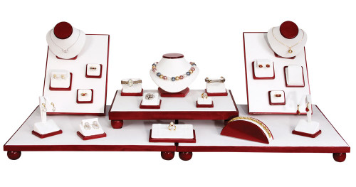 35 piece Showcase Jewelry Display Set with Rosewood trim and white faux leather.