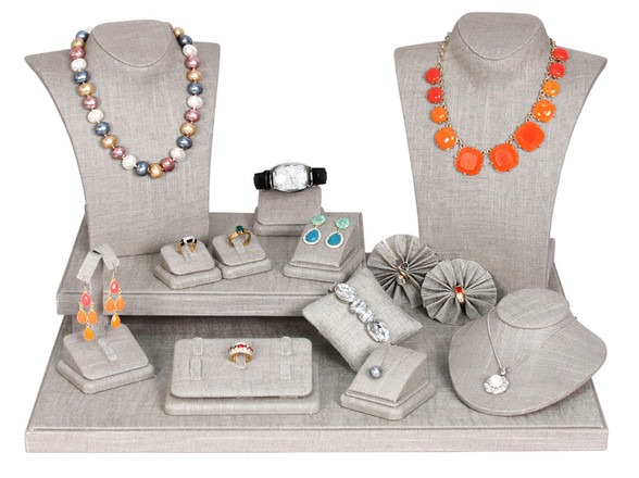 The Latest: Grey Linen Jewelry Displays