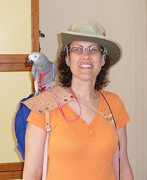 Sharon and Clover, a smart African Grey standing on shoulder