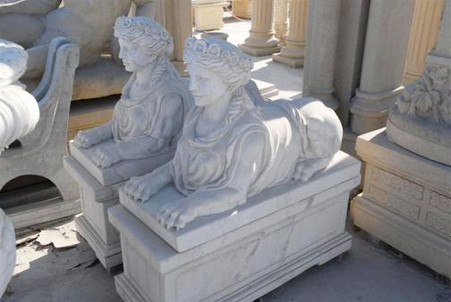 STATELY MATCHING PAIR OF MARBLE SPHINX ON PEDESTALS IN WHITE MARBLE