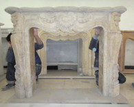 FRENCH INSPIRED MARBLE FIREPLACE MANTEL IN TRAVERTINE Measures: 59 wide x 46 tall x 13.75 deep. Opening Measures: 38.5 wide x 33 tall.