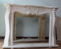 Hand carved marble fireplace mantel in Beijing White. Features a delicate shell in the center with lovely carvings surrounding it. The rest of the mantel is minimalistic, giving a clean look.  Dimensions:  Whole size is L: 59 x H: 43.3 x W: 11.8 (Inches), Opening is L: 38.6 x H: 32.5 (Inches).   Before purchasing, please contact us for availability and shipping quote.