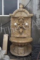 MARBLE WALL FOUNTAIN WITH CARVED FACES & LIONS HEAD, LIGHTED FIXTURE
