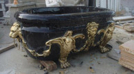 MAGNIFICENT VICTORIAN BLACK HAND CARVED MARBLE BATH TUB WITH BRONZE CLAW FEET Measures: 86 long x 46.5 tall x 31.2 wide.