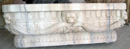 Newly finished marble bath tub. All hand carved from a single block of marble. This tub has lion heads with ring in mouth throughout the exterior. Great quality, is much more impressive in person. Drainage hole is already drilled in the basin. Measures: 32 wide x 79 long x 26 tall.