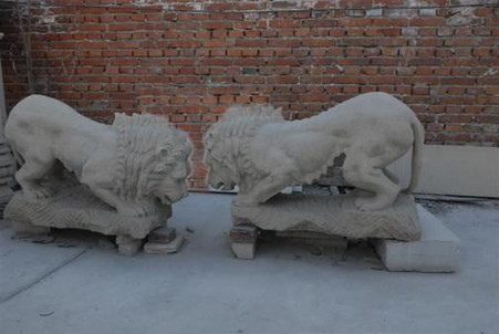 HAND CARVED PAIR OF CROUCHING SANDSTONE LIONS