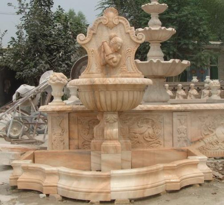 New just finished marble wall fountain. Great Victorian design in this piece. The water pours from the bowl in the carved woman\'s hands and then cascades into the collection pool. The coping is included in this fountain set. Measures: 89 wide x 85 tall x 56 deep.
