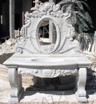 This is a new design that was just completed...all hand carved from solid marble. This sink is ready for install and also comes up a cutout for a mirror. We leave the plumbing holes uncut for the faucet..based on your faucet design holes can be drilled. We can carve this piece in any color. Measures 60.5 wide x 27.5 deep x 72.25 tall.  Before purchasing, please contact us for availability and shipping quote.