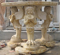 HAND CARVED ROUND MARBLE TRAVERTINE TABLE, WITH MYTHOLOGICAL ANGEL CARVINGS 48""