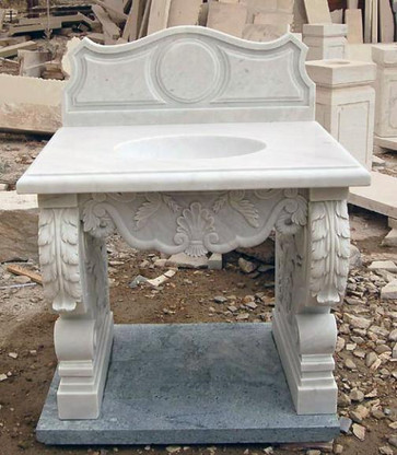 This is a marble sink design that was just completed.  The sink is precut for drainage and faucet. Can have this same design carved out of any color or marble or granite. If you require larger quantities or specific measurements for your project please give us a call. Measures: 35 wide x 27.5 deep x 44 tall.