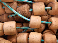Used Brown Cork Floats On Rope