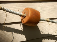 Brown Cork Floats Spaced On Rope