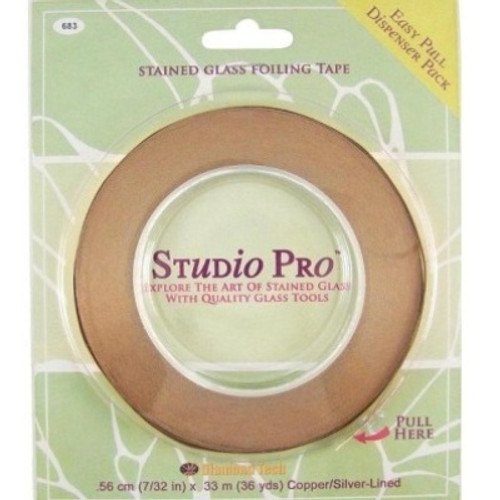 """Studio Pro Foil offers outstanding tack and remarkable resistance to temperature and weathering. All foils attach securely to glass edges and corners to provide a smooth, uniform solder bead. The unique """"Easy Pull"""" plastic dispenser makes for trouble-free application and kink-free storage. This foil is coating with a silver backing and is available in 7/32"""" and 1/4"""" widths. Sold in 36 yard roll."""