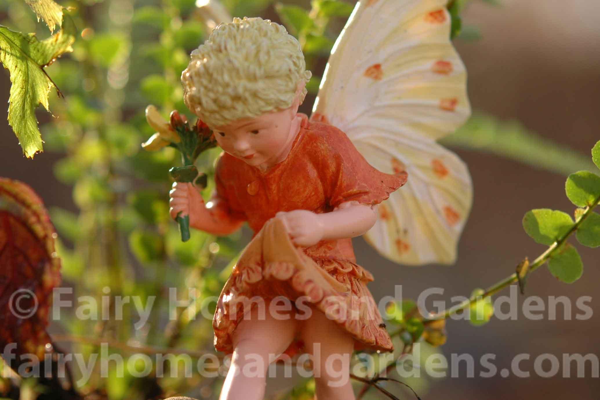 close up of fairy in terrarium