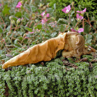 Little Fairy Sleeping Wrapped in a Brown Leaf