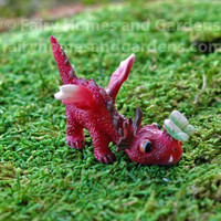 Miniature Baby Red Dragon with Tiny Green Butterfly on His Nose