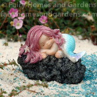 Sleeping Little Mermaid on Black Rock