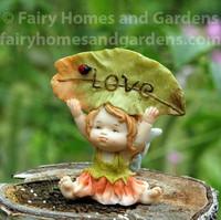"Little Fairy Caroline Holding a ""Love"" Sign"
