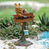 "Miniature Squirrel Painting a ""Welcome"" Sign"