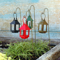 Miniature garden lanterns on a wire hook.