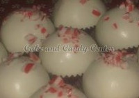 White cake pops dipped in white chocolate and sprinkled with peppermint crunch.