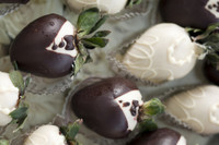 A unique wedding idea!  Our hand dipped strawberries are dipped to simulate the Bride & Groom.  Order for your bridal shower or wedding.  The guests will be delighted with the delicious dessert.