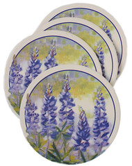 "Set of four decorative absorbent coasters from ""Thirstystone"" Each 4 1/4"" coaster has a cork base to protect furniture"