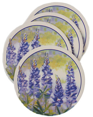 """Set of four decorative absorbent coasters from """"Thirstystone"""" Each 4 1/4"""" coaster has a cork base to protect furniture"""