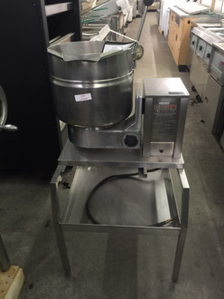Used-Kettle, electric, table top, 20-quart capacity, 2/3 jacket, 304 stainless steel liner, hand tilt, faucet bracket, support console on right, stainless steel construction. 208v/1ph/60hz. 30 Day Warranty from Date of Purshase