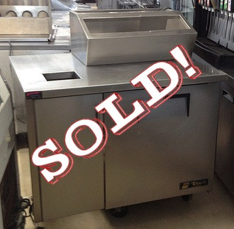 "USED-True sundae station, (8) 1/6 size (4""D) poly pans, series stainless steel top/front/sides, aluminum back, (1) door, (2) shelves, white aluminum interior with stainless steel floor, left side cabinet for trash container with door, 42""W x 31""D x 37""H, 1/5 HP, 115v/60/1, 4.9 amps, 7' cord, NEMA 5-15P, cULus, NSF, CE, MADE IN USA"