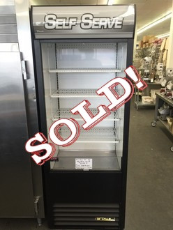 """NEW True TAC-30LD Vertical Air Curtain Merchandiser, 30-1/4""""L, 80-5/8""""H, (4) white PVC-coated shelves, vinyl exterior, white aluminum interior with stainless steel floor/deck pans, LED interior lighting, leg levelers, 1/2 HP, 115v/60/1, 12.0 amps, NEMA 5-20P, 6.5' cord, cULus, CE, NSF, MADE IN USA. 3 year warranty parts & labor, 5 year on compressor."""