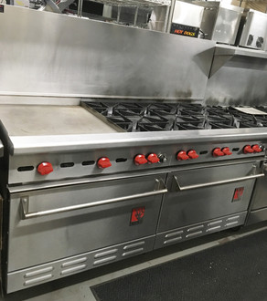 "USED Wolf 68"" Range. 8 Open Burners & 22"" Griddle, 2 Standard Ovens, Natural Gas, Front, sides, back riser and high shelf finished in stainless steel. Stainless steel bullnose, front manifold cover and 6"" adjustable legs. 26,000 BTU/hr. open burners with lift-off heads. Flashtube pilot ignition system for automatic burner lighting, Full width pull out crumb tray. 30,000 BTU/hr. standard oven measures 29""w x 22""d x 13""h. Thermostat adjusts from 250 to 500 F. One oven rack and four rack positions, 67 1/4""w x 32 3⁄4""d x 57 1/2""h on 6"" adjustable legs. 37"" working height."