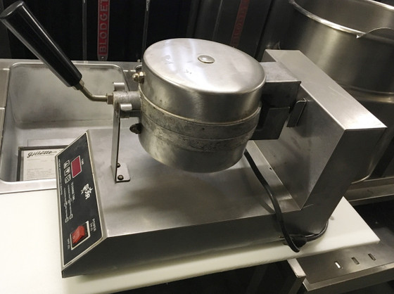 """Waffle Bakers are built of polished stainless steel and heavy-duty cast aluminum grids, uniform top and bottom. The grids are 7"""" producing a 1-1/4"""" and 8"""" diameter producing a 1"""" thick Belgian Waffle. The unit has a heavy-duty aluminum hinge for opening the top assembly when loading waffle mix and for rotating by 180o the head assembly when cooking. The Belgian Waffle Baker has metal sheathed tubular elements in both grids. A electronic temperature control to provide better temperature control. Belgian Waffle Bakers has digital electronic timer with precision settings, heavy-duty rocker switch with an indicator light and a stainless steel drip tray. The model SWB7RB has a NEMA 5-15 plug for 120V"""