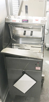 "Berkel Gravity Feed Bread Slicer Handles up to 600 Loaves per Hour Loaf size up to 16""L x 5-5/8""H 7/16"" Slicing Pullout crumb tray for easy cleaning 120V 60Hz 1Ph O.A. Dims: 25-1/2""W x 45""D x 62""H"