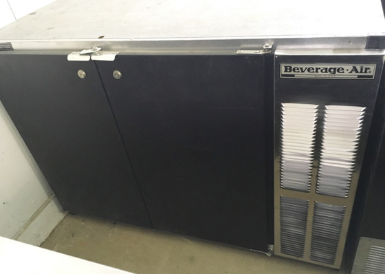 """Refrigerated Back Bar Storage Cabinet, two-section, 48""""W, 34"""" H, 12.4 cu. ft., (2) solid doors, snap-in door gasket, (4) epoxy coated steel shelves, (2) 1/2 barrel kegs, LED interior lighting with manual on/off switch, galvanized top & interior, black exterior finish, right-mounted self-contained refrigeration, R290 Hydrocarbon refrigerant, 1/4 HP, UL, cULus, UL EPH CLASSIFIED, UL-Sanitation, MADE IN USA"""