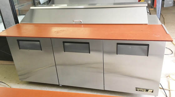 "Sandwich/Salad Unit, (18) 1/6 size (4""D) poly pans, stainless steel insulated cover, 11-3/4""D cutting board, stainless steel top/front/sides, aluminum back, (3) full doors, (6) shelves, aluminum interior with stainless steel floor, 5"" castors, R290 Hydrocarbon refrigerant, 1/2 HP, 115v/60/1, 7.2 amps, NEMA 5-15P, cULus, UL EPH Classified, MADE IN USA"
