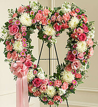 "•Floral heart arrangement of fresh pink and white flowers, including roses, stock, carnations and more •Comes on a wire easel with accents and satin ribbon •Appropriate for family and friends to send directly to the funeral home •Our florists use only the freshest flowers available, so colors and varieties may vary •Measures approximately 34""H x 32""L without easel"