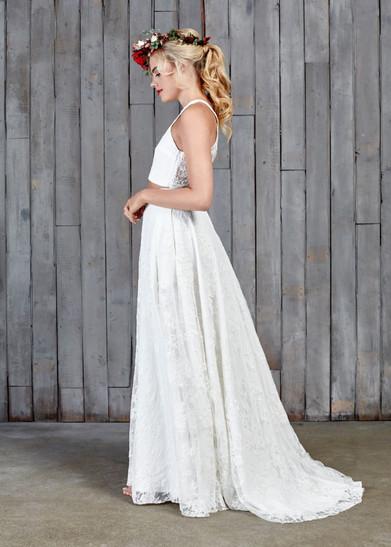 This beautiful, full-length bridal skirt is our most bridal of all of our two-pieces. Made with a pretty, ivory lace complete with a 5cm puddle train to subtly sit behind you. The Stevenson skirt features here with the Stevenson top.