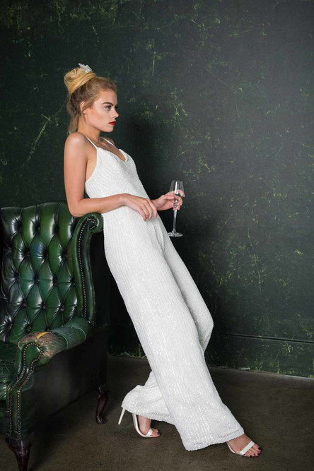 Stunning, embellished bridal jumpsuit. With super sexy straps, subtle wide trouser legs and nipped in at the waist, this beautiful bridal jumpsuit is handmade in London.