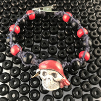 HOTI Hemp Handmade Skeleton Pirate Head Earring Peruvian Ceramic Gray Grey Hemp Black Red Wood Beads Mens Bracelet Hand Crafted Made in Toronto Made in Ontario Made in Canada Tattoo Punk Rocker Beaded Crow Beads Alligator Clip Roach Clip Clip It 420 Clip Toronto Ontario Canada