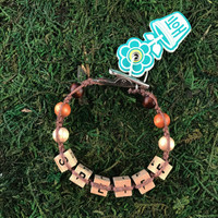 HOTI Hemp Handmade Spliff Brown Hemp Square Wood Cube Alphabet Natural Beads Dark Caramel Beige Light Round Bead Men's Women's Ladies  Man Woman Jewellery Unisex Word Up Roach Clip Bracelet Hand Crafted Made in Toronto Made in Ontario Made in Canada Beaded Wood Beads Square Beads 420 Alligator Clip Weed Accessory Pot Accessories Marijuana Cannabis Stoner Clip It Clip Toronto Ontario Canada Canadian Jewelry